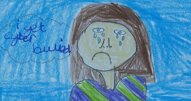 """Drawing of a young person crying with the words """"I get cyberbullied"""" written in a bubble by her head"""